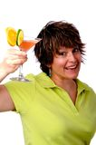 Cheers. Woman holding up a drink to cheer Stock Photo