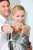 Cheers!. Couple toasting end to great financial year Stock Image