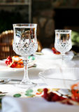 Cheers. Photo of table set with sparkling wine glasses royalty free stock image