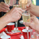 Cheers. Group of friends or family celebrating and toasting with champagne; cheers royalty free stock photos