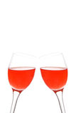 Cheers. Two glasses with a drink together, isolated on a white background Stock Images