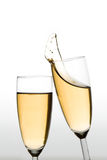 Cheers. Glasses of champagne clinking. Gradient background from light grey to pure white stock images