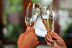 Cheers. A couple celebrates with a toast Stock Photography