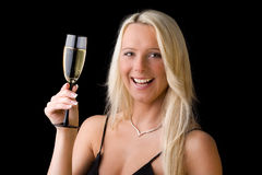 Cheers. A young woman with a glass of sparkling wine Stock Photography