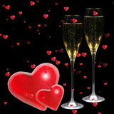 Cheers!. Valentine hearts with champagne flutes on black background Royalty Free Stock Image