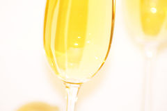 Cheers. Two champagne glasses small dof Royalty Free Stock Photos