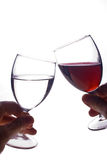 Cheers. Two glasses in contact suggesting celebration royalty free stock images