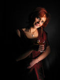 Cheers!. Woman a dark background painted with light. Artistic blur Stock Photos