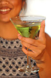 Cheers!. Woman cheering with apple martini stock photography