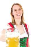 Cheers. Beautiful woman in dirndl saying cheers Royalty Free Stock Image