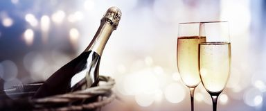 Cheers with a bottle of champagne for a new year royalty free stock photos