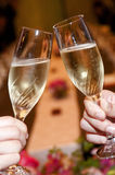 Cheers. Bride and groom, toast at wedding reception Stock Photography