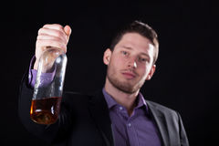 Cheers of a businessman with a bottle Royalty Free Stock Image