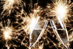 Cheers. champagne glasses with fireworks in background Royalty Free Stock Photo