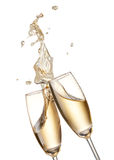 Cheers with champagnes. Two glasses of champagne toasting creating splash royalty free stock photo