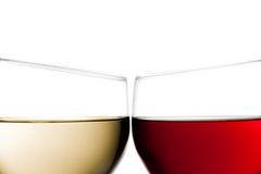Cheers, closeup of two glasses of red wine and white wine Stock Photo