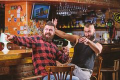 Cheers concept. Hipster brutal bearded man drinking alcohol with friend at bar counter. Men drunk relaxing at pub having. Cheers concept. Hipster brutal bearded stock photos