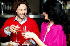 Cheers! Couple celebrating their love together Stock Photography
