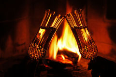 Cheers by the fire Royalty Free Stock Photo