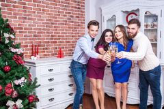 Cheers! Four happiness best friend celebrating christmas. Stock Photography