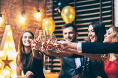 Cheers! Friends with glasses of champagne during party celebration. New year, Birthday, Holiday Event concept stock images