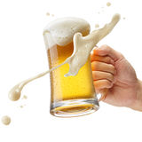 Cheers. Hand holding a mug of beer toasting Stock Photography