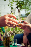 Cheers! Hand toasting with glasses of brandy Stock Image