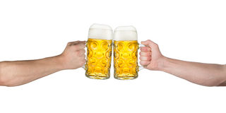 Cheers hands oktoberfest. Cheers! hands holding up german beer mugs Royalty Free Stock Photo