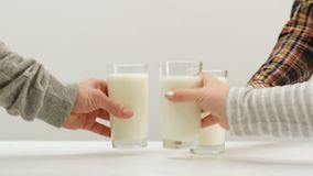 Cheers healthy milk drink three glasses dairy. Cheers! Healthy drink for everyone. Three glasses of milk for every family member. Dairy products. Calcium stock video footage