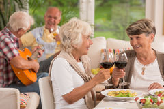 Cheers for husbands!. Happy senior women drinking red wine  for husbands Stock Images
