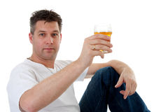 Cheers, man is toasting with beer Royalty Free Stock Image