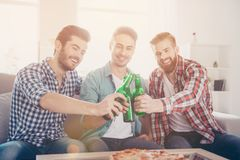 Cheers men! Bachelor men`s life. Close up of three happy friends stock images