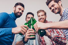 Cheers men! Bachelor men`s life. Low angle photo of four happy f stock images