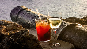 Cheers. One last drink after a great holiday in Greece. A lovely terrace in an historic part of the island Skiathos, sunset, a drink and good company. What more Stock Image