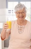 Cheers with orange juice Stock Image