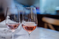 Cheers with pair of wine glasses Royalty Free Stock Images