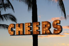 Cheers. Party sign with lights that says cheers Stock Images