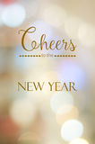 Cheers to the new year on abstract blur bokeh background Royalty Free Stock Photo