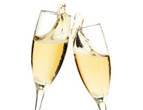 Cheers! Two champagne glasses. Closeup, isolated on white stock image