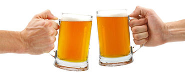 Cheers, two glass beer mugs isolated on white. Background royalty free stock photo