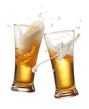 Cheers. Two glasses of beer toasting creating splash stock image