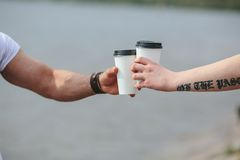 Cheers using two cups of coffee Royalty Free Stock Images