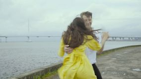Cheery boy and girl dance emotionally some swift jazz bop on a pier on a sea coast stock video