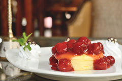 Cheery cheesecake. Dessert Cheery cheesecake on desk in restaurant Stock Photography