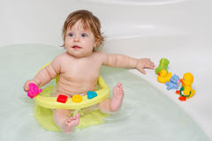 Cheery cute baby girl in a bath Stock Photo