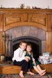 Cheery Siblings at Christmas Stock Photo