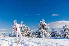 Cheery skier on the top of mountain. Cheery skier posing on the top of mountain in Sarikamis royalty free stock photo