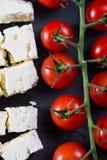 Cheery tomatoes and feta cheese. Fresh cheery tomatoes and feta cheese Stock Photo