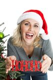 Cheery woman with Christmas ornament Royalty Free Stock Photography