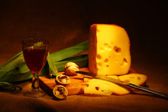 Chees with wine-glass and with knife. On brown background Stock Photography